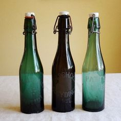 vintage Belgian beer bottle with hinged porcelain cap – gorgeous blue green glass color with etched name CALLEWAERT and city (ZWEVELE). Available at AtticAntics, $22.00