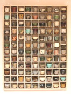 OH, how I want this beautiful grid of delicious little cups hanging in my kitchen or dining room.