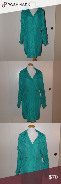 Kenneth Cole New York Blue Anorak Rain Coat Super cute and in great condition Kenneth Cole New York cinch-waist aqua blue Anorak Raincoat. This is the cutest jacket to pair with rain boots for the upcoming winter season! Kenneth Cole Jackets & Coats