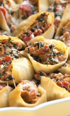 This family-friendly stuffed shells recipe with spinach, sausage, tomato and ricotta cheese will make just about anyone reach in for more. Recipe on inspiredtaste.net