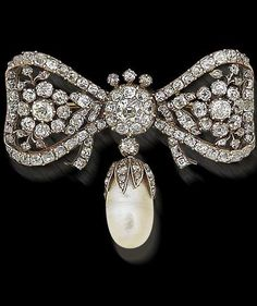A diamond and pearl bow brooch, 18th and 19th century The tied ribbon bow with stylised floral detail, set throughout with old brilliant-cut diamonds within closed-back settings, suspending a later baroque pearl drop with rose-cut diamond cap, mounted in silver, diamonds approximately 6.75 carats total, pearl untested, later brooch fitting, width 5.3cm, length of pearl drop 2.5cm, shagreen case