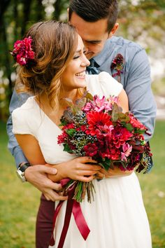 Wedding Bouquet for bride and shot with groom. Gorgeous red maroon purple magenta hues