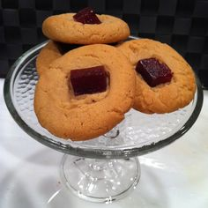 """Inspired by my Cuban grandfather's """"polvorone"""" recipe, these have an American twist. Peanut butter polvorone cookies topped with a sweet guava paste square. PB cookie with Cuban roots. ;-)"""