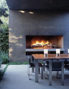 Outdoor fireplace and ding ....very stylish modern Marmol Radziner