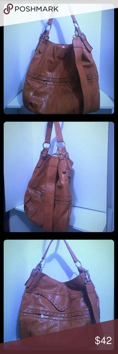 Jessica Simpson tan leather bag Large tan leather purse. Option of 2 shoulder straps; one long adjustable. Has three outside roomy zip pockets. Inside has three pockets, two that zip. Can be worn as a large crossbody or just remove the long strap and wear as a shoulder bag. Great for traveling or everyday use!🙌 Great condition. Jessica Simpson Bags