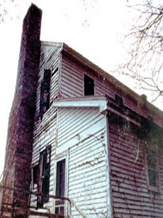 This is a real Haunted House Ghost Photo I took On a trip to Kentucky, says Wes Hannon a well seasoned Paranormal Investigator from New York. Look at the windows and you will see the ghosts of a man and a child looking out!