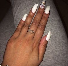 Square almond shaped nails painted with white gel