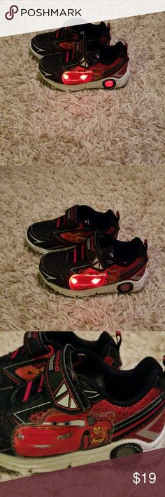 Disney Cars light-up sneakers Headlights and wheels light up - all lights work  Great condition, very minimal wear since he only wore them a few times before outgrowing them.   Purchased new March 2017  Faux laces with Velcro closure Disney Shoes Sneakers