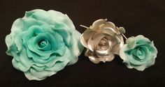 Check out this item in my Etsy shop https://www.etsy.com/listing/264291642/3-edible-roses-gum-paste-fondant-any