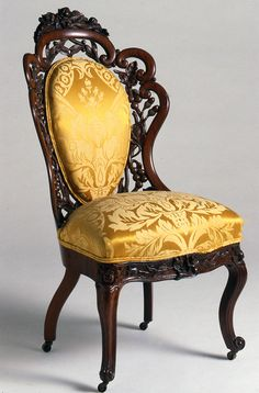 Victorian Period 1840-1900 created by Henry Belter. It has a flat back with a design around the outside of it.