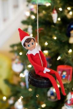 Elf on the Shelf on a tire swing! Maybe Santa will bring him his own Creative Playthings swing set, complete with a tire swing. :)
