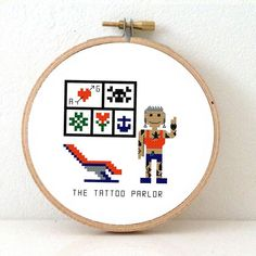 2 x Tattoo parlor cross stitch pattern. Embroidery pattern to make a DIY gift for a tattoo artist. Both Female and Male version. Designed by #studiokoekoek