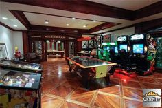 Game Room / Man Cave.  I'd be THRILLED with my favorite seven or eight coin-ops and a foosball table.  Throw in air hockey, ping pong and another half dozen arcade favorites? I'd think I hit heaven, lol :D