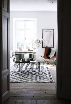 Lately I like the idea of mixing the brown leather chair with the black/white and gray tones.