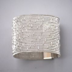"""Bracelet   LILIA BREYTER-AR """"Colección Texturas"""". With refined strands of fine silver she obtains different textures, soft as silk and resistant and permanent as the noble metal she weaves"""