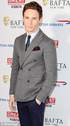 Stylish: The actor wore a smart double-breasted grey blazer of a light blue shirt and patterned navy tie