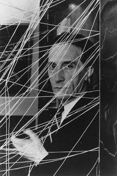 """Marcel Duchamp inside  """"16 Miles of String"""",  1942"""
