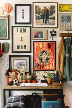 "Gallery wall. On the floor, put tape to reflect area you are hanging in. Lay out the items to be hung, starting with the ""important"" or focus piece and work outward. Stand on a chair and get a picture. Then, hang it all!"