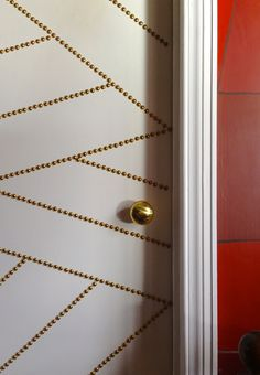 Door with bright brass nailing.