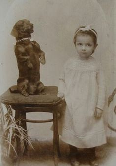 historicalpets: A sweet little girl posing with her dachshund who is standing up on his back legs for a pose, c. 1890s-1900s