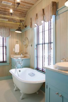 Pale timber and light blue are a lovely combination for a cottage styled bathroom.