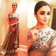 A very charming @aliaabhatt who has tried it all in fashion and then some, finally wore her first sari which was a gorgeous @manishmalhotra05 creation. Doesn't she do complete justice to the cold shoulder blouse and that sequin-spangled fabric? #VerveSpotted #VerveRevival #Sari #Fashion #Bollywood #instacool #instadaily #instagood #photooftheday