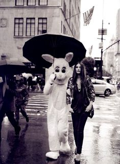 """Catherine Mcneil and the bunny ( Robert Buckley ) by PETER LINDBERGH """"Street Chic"""" editorial from Harper's Bazaar march 2009"""