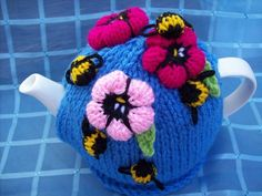 tea cosy - knitted, but the colours & definition are perfect. easily convert to crochet or adapt another pattern.