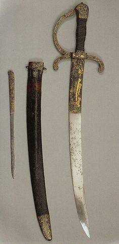 """Hunting Sword used by Henry VIII.  Hunting was viewed as """"an essential mark of a gentleman and...was valued as a test of courage, strength, and agility..."""" (Tudor England: An Encyclopedia, 327). It became a main """"pastyme"""" of the Tudor monarchs, especially Henry VIII.  Bows and arrows, crossbows, and even guns were used when hunting. Another weapon yielded was the hunting dog."""