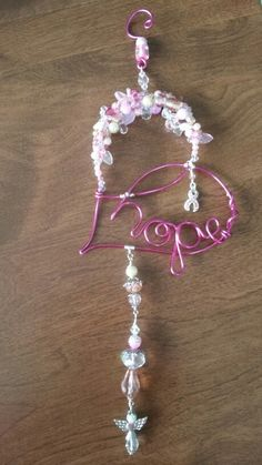 Wire wrapped beaded sun catcher heart of hope. Breast cancer awareness charm.