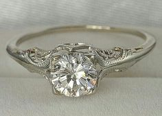 Vintage engagement ring (the diamond doesn't need to be that big though but love the detailing) <3