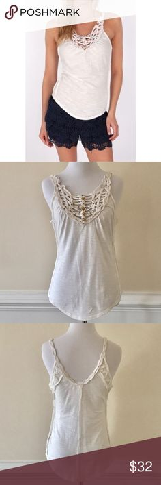 """New Free People Toosaloosa Slub Woodstock Tank Ivory tank with beading at the collar and crocheted braided straps and raw edges.  Tag cut to prevent store returns.  Approx.  23.5"""" length Free People Tops Tank Tops"""