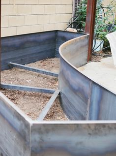 adding more cor-ten steel beds in our backyard