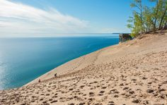 A truly incredible gem hidden in Middle America, Michigan's Sleeping Bear Dunes National Lakeshore offers a diverse area of woods, beaches, and fields, not to mention incredible sand dunes that give the place its name. The incredibly picturesque camping areas overlook the sloping dunes and sea-sized Lake Michigan. For extra adventure points, bring a kayak and go a paddle at sunrise.   - CountryLiving.com