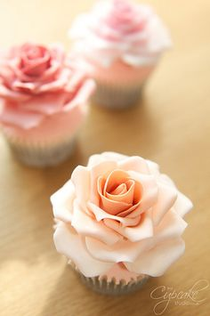 Roses made from florist paste in dusky pinks and peach on chocolate cupcakes with vanilla buttercream x    www.thecupcakestudio.co.uk