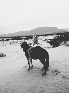 A girl and a horse and miles of sand. Sagittarius