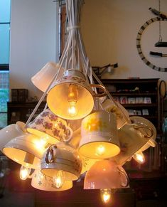 DIY lamps with cups. Beautiful, but how do you get wholes in the bottom of the cups?