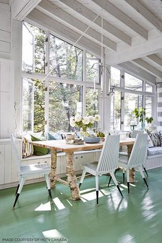 Cottage dining table with tree branch legs.