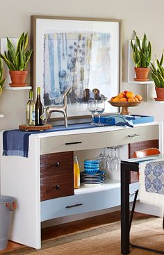 Transform an old dresser into an elegant buffet complete with racks for glasses and fresh new hardware.