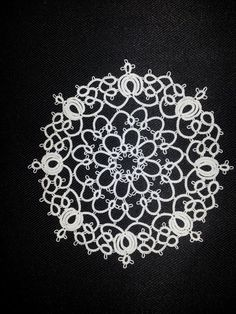 Onion Rings doily (designer unknown) Tatted in Lizbeth Cream thread by me.