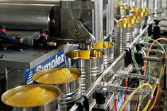 Stock Photo #293H-133C, Cans being filled with jam on an assembly line