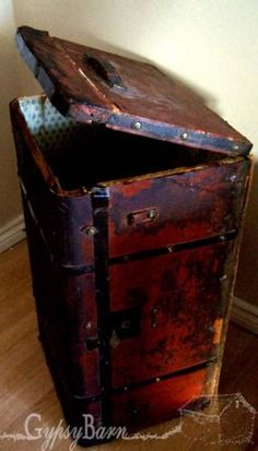 repurpose an old trunk as a garbage can