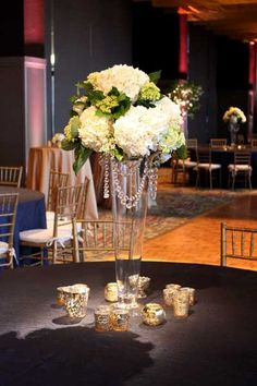 Super sleek and modern, glass pilsner vases are perfect for this Hyatt reception.  Floral design by http://www.harveydesigns.com