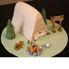 Brides.com: Unique Groom's Cakes Since the groom is an avid outdoorsman, cake designer Katy Zimmerman created a cozy campsite from fondant and gumpaste—complete with a tent, campfire, and even s'mores!—for the newlyweds.   Cake design by The Happy CakePhoto: Courtesy of Katy Zimmerman/The Happy Cake