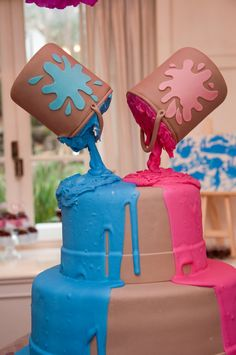 Gender reveal cake or boy/girl birthday party cake using paint can decorations
