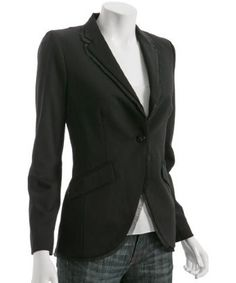 The basic black blazer with a white tee and dark blue jeans.