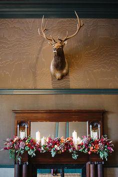A flower-covered mantel | Brides.com