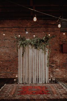 Boho-inspired ceremony space featuring lush greenery, a patterned rug, and candl. Boho-inspired ceremony space featuring lush greenery, a patterned rug, and candles Indoor Wedding Ceremonies, Wedding Ceremony Decorations, Wedding Ideas, Wedding Backdrops, Decor Wedding, Industrial Wedding Decor, Wedding Centerpieces, Indoor Wedding Arches, Wedding Planning