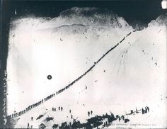 Miners and prospectors climb the Chilkoot Trail during the Klondike Gold Rush, 1898.