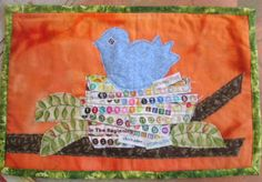 Items similar to Little Blue Bird in Selvage Nest Mini Quilt - Applique - Art Quilt on Etsy